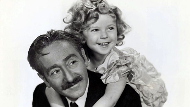 With Adolph Menjou in Little Miss Marker, her first title role.