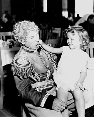 Shirley clowns with Harpo Marx.